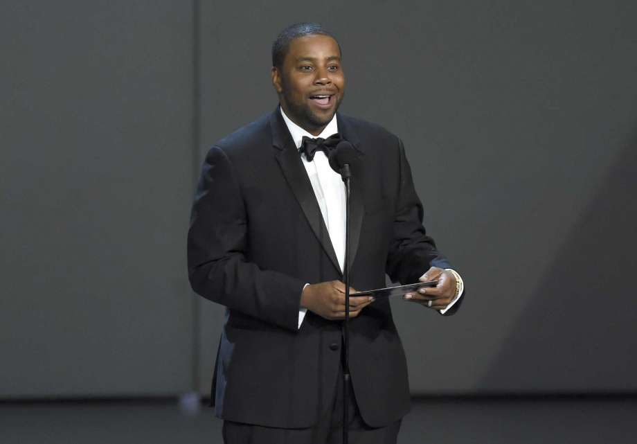 """FILE - In this Sept. 17, 2018, file photo Kenan Thompson presents the award for outstanding drama series at the 70th Primetime Emmy Awards at the Microsoft Theater in Los Angeles. NBC didn't invoke its """"must-see TV"""" 20th-century marketing slogan in announcing a renewed emphasis on sitcoms next season, but it could have. Calling comedy the """"heart"""" of its brand, the network announced it is adding four new sitcoms to its lineup for 2019-20, with stars including Kenan Thompson of """"Saturday Night Live"""" and sitcom veterans Fran Drescher (""""The Nanny"""") and Steven Weber (""""Mom,"""" ''Wings""""). (Photo by Chris Pizzello/Invision/AP, File) Photo: Chris Pizzello, Chris Pizzello/Invision/AP / Invision"""