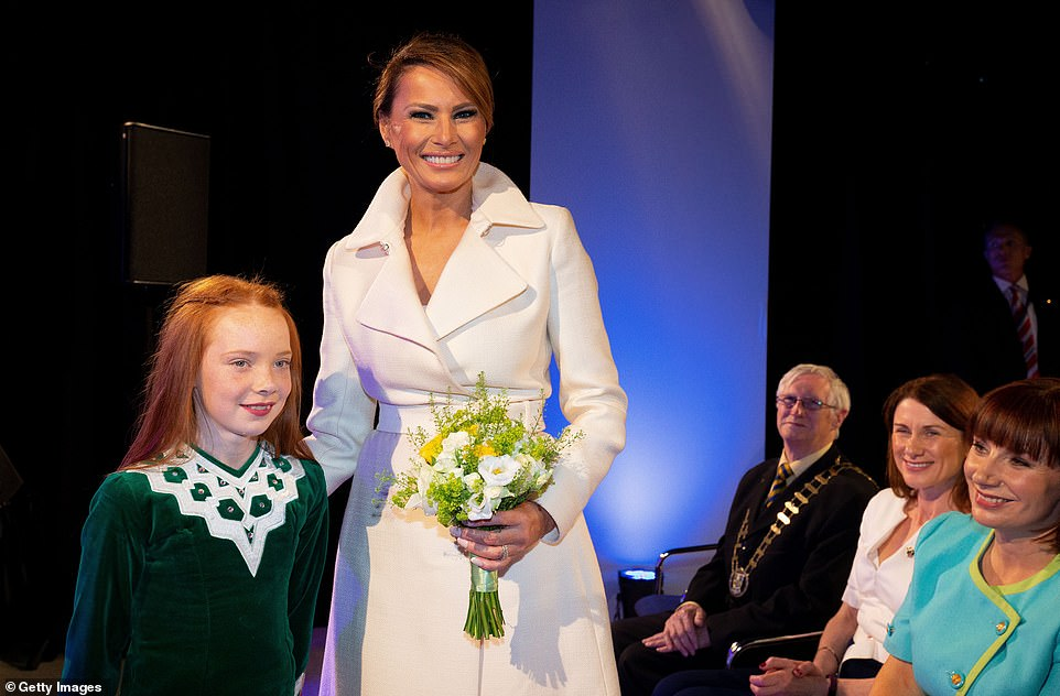 The First Lady was presented with a bouquet of flowers by one of the dancers, before she flew on to Doonbeg, Co Clare