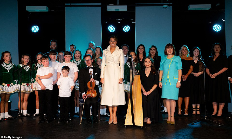 Melanis posed with the dancers and musicians during the First couple's brief stop in Shannon yesterday afternoon