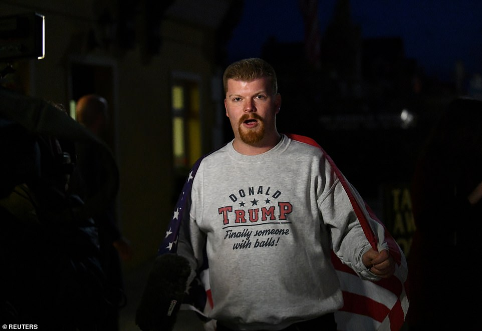 A supporter of U.S. President Donald Trump is seen during a visit by Trump's sons Eric and Donald Trump Jr. to a local pub in Doonbeg